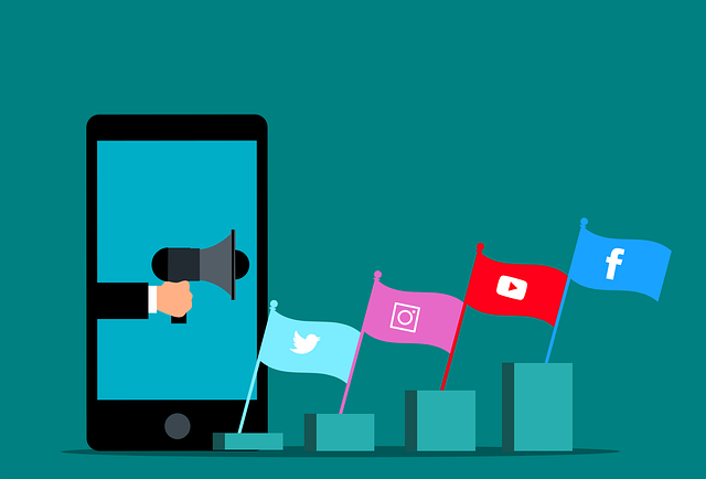 cellphone showing a megaphone pointing four flags with social media icons on them